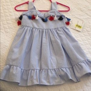 Other - Beautiful dress with red, white and blue tassels.